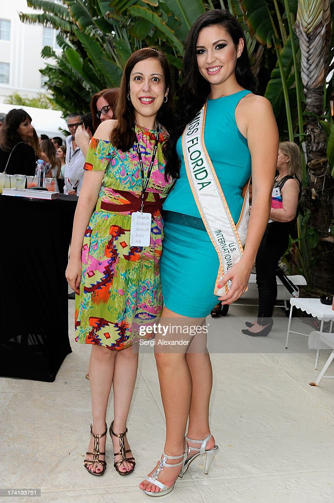 Ailyn Diaz (L) and Miss Florida USI Cassandra Mandeville attend the ABEST & ABIT Brazilian Swimwear Designers Cocktail Party during Mercedes-Benz Fashion Week Swim 2014 at The Raleigh on July 20, 2013 in Miami, Florida.