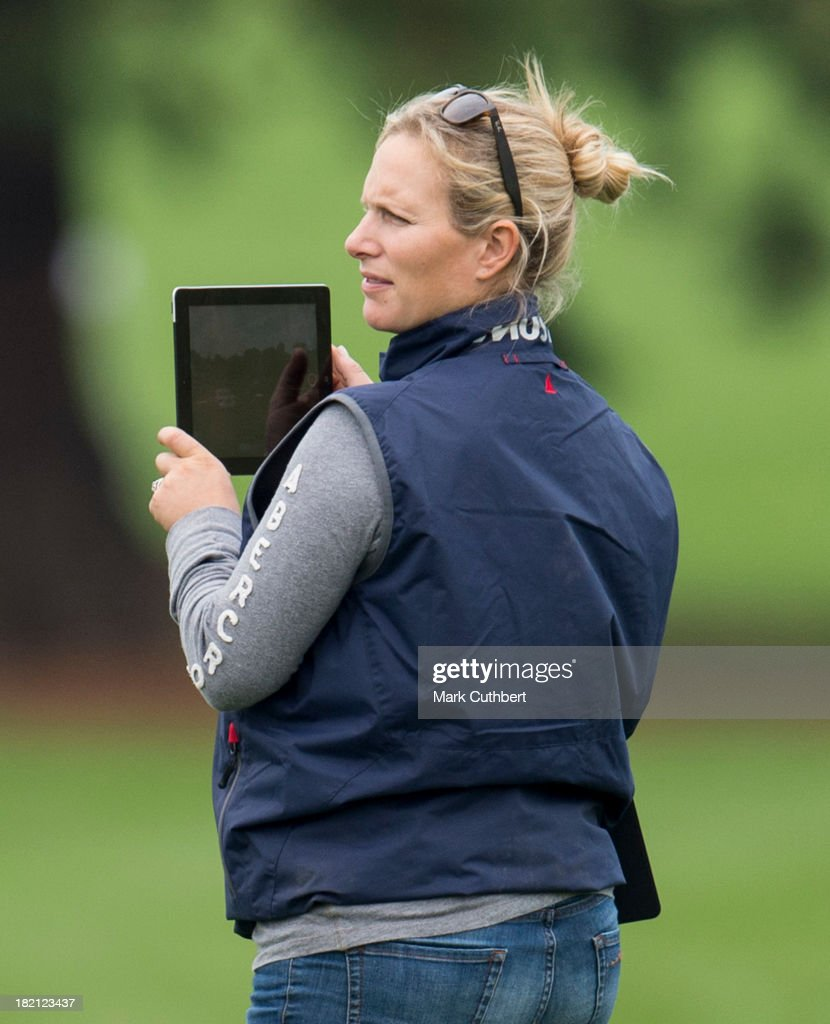 Aimee Aspinall riding 'Disarm' during the Dressage is videoed by <a gi-track='captionPersonalityLinkClicked' href=/galleries/search?phrase=Zara+Phillips&family=editorial&specificpeople=161323 ng-click='$event.stopPropagation()'>Zara Phillips</a> on her iPad, at The Moreton Morell Horse Trials at Warwick College on September 28, 2013 in Warwick, England.