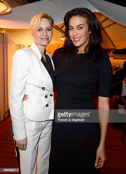Aimee Mullins and Megan Gale attend the L'Or Sunset Showcase with Micky Green for L'Oreal during The 66th Annual Cannes Film Festival at Hotel...