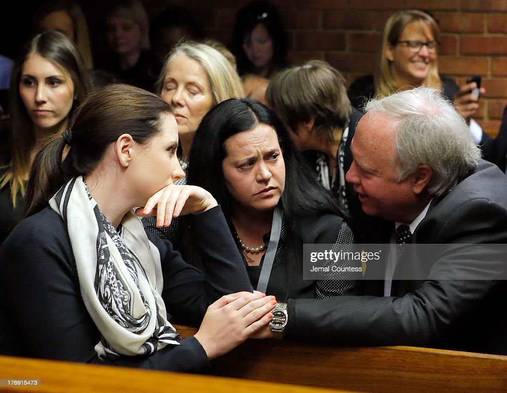 Aimee Pistorious is comforted by Theo Pistorious prior to the indictment hearing for South African athelete Oscar Pistorius at Pretoria Magistrates...
