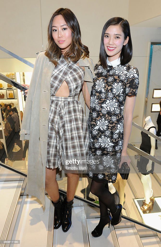 Aimee Song and Tao Okamoto attends the Michael Kors Miranda Eyewear Collection Event on February 18 2015 in New York City