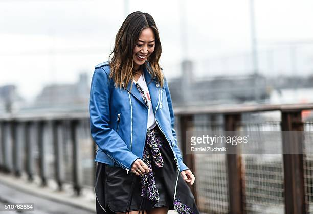 Aimee Song is seen outside the Coach show wearing a blue Coach leather jacket during New York Fashion Week Women's Fall/Winter 2016 on February 16...