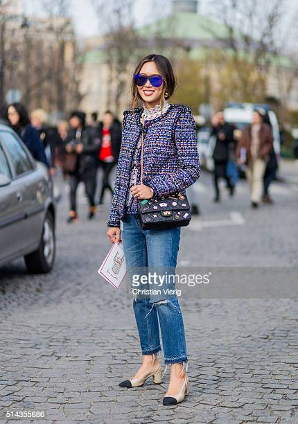 Aimee Song is wearing a Chanel blazer jacket and Chanel sunglasses and black bag and ripped blue denim jeans and Chanel shoes outside Chanel during...