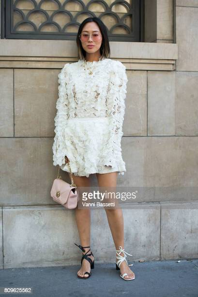 Aimee Song poses after the Elie Saab show at the Pavillion Cambon during Paris Fashion Week Haute Couture FW 17/18 on July 5 2017 in Paris France