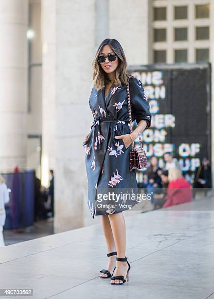 Aimee Song wearing a Dior bag and Rochas dress during Paris Fashion Week Womenswear Spring/Summer 2016 on September 30 2015 in Paris France