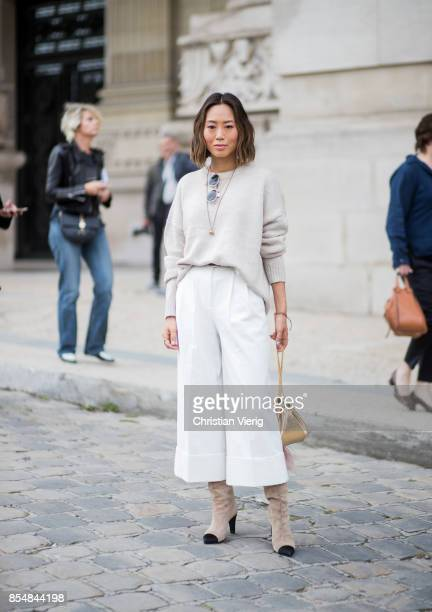 Aimee Song wearing white cropped pants knit is seen outside Maison Margiela during Paris Fashion Week Spring/Summer 2018 on September 27 2017 in...