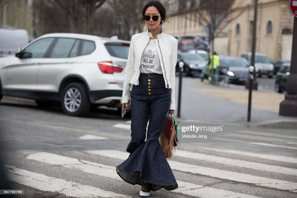 Aimee Song wears a Dior 'We Should All Be Feminists' tshirt outside the Loewe show on March 3, 2017 in Paris, France.