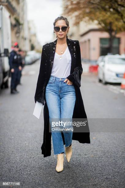 Aimee Song with braids hair wearing denim jeans black coat seen outside Sacai during Paris Fashion Week Spring/Summer 2018 on October 2 2017 in Paris...