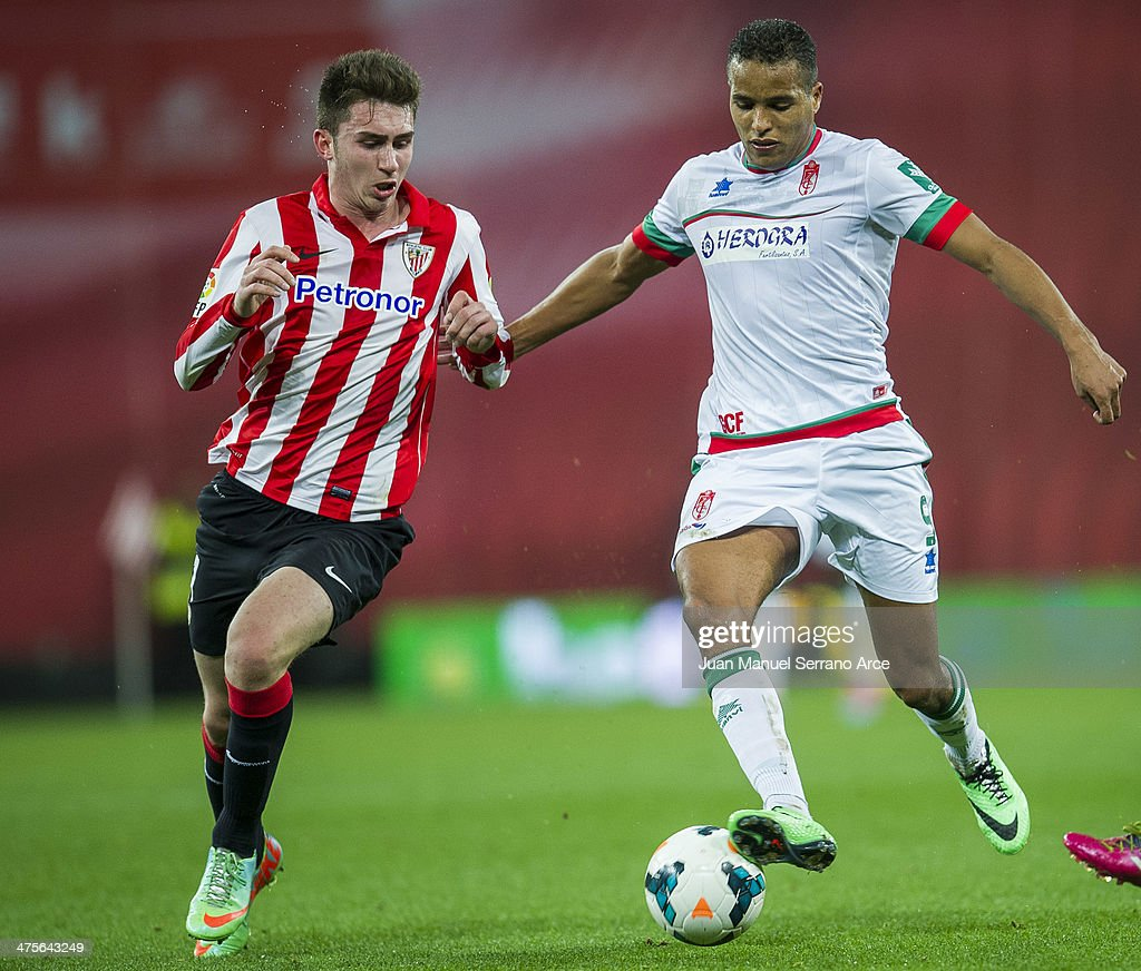 Aimeric Laporte of Athletic Club Bilbao competes for the ball with Youssef El Arabi of Granada CF during the La Liga match between Athletic Club Bilbao and Granada CF at San Mames Stadium on February 28, 2014 in Bilbao, Spain.