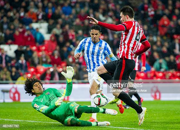 Aimeric Laporte of Athletic Club duels for the ball with Guillermo Ochoa of Malaga CF during the Copa del Rey Quarter Final Second Leg match between...