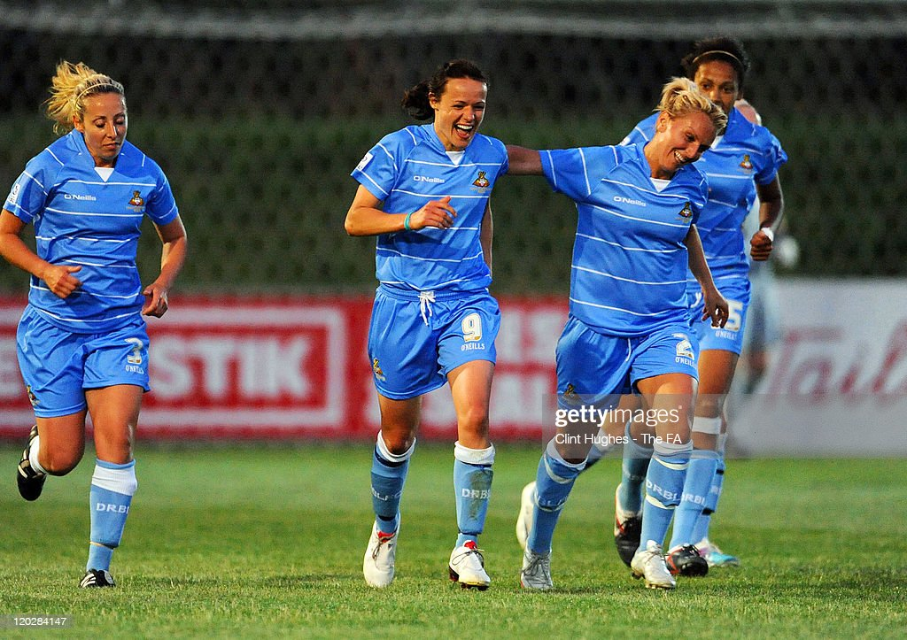 Aine O'Gorman of Doncaster celebrates with her teammates after scoring her side's first goal during the FA Women's Super League match between...