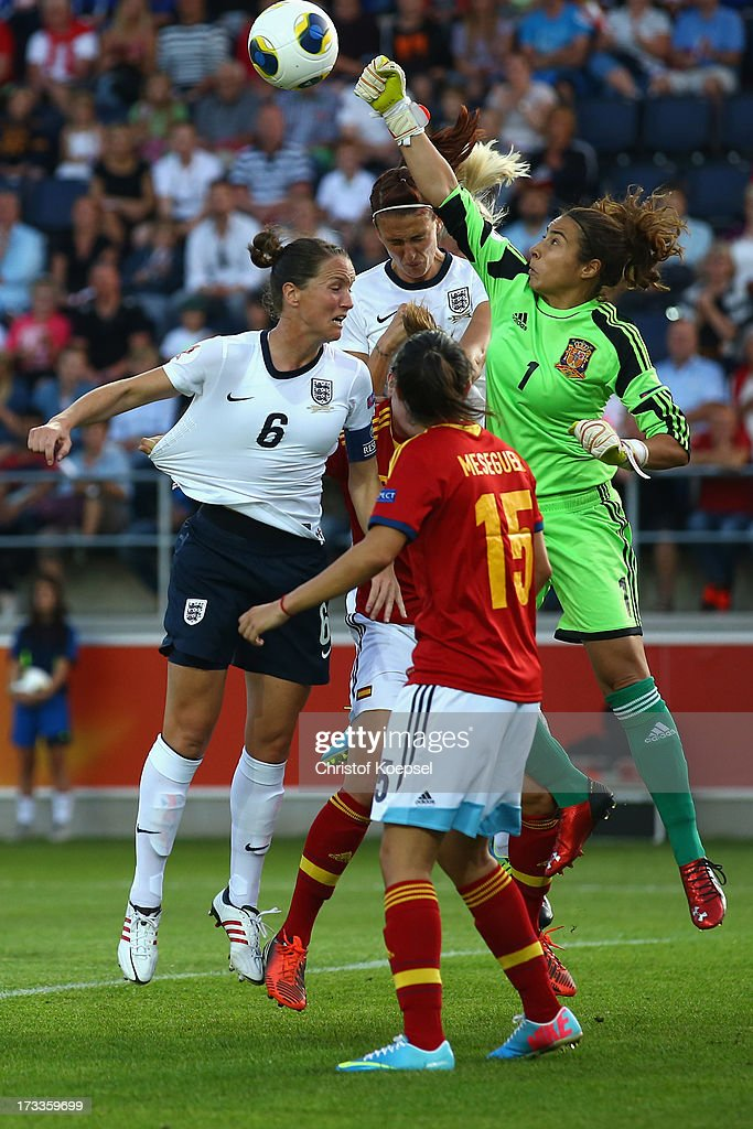 Ainhoa Tirapu of Spain (R) saves against <a gi-track='captionPersonalityLinkClicked' href=/galleries/search?phrase=Casey+Stoney&family=editorial&specificpeople=2357476 ng-click='$event.stopPropagation()'>Casey Stoney</a> (L) and Jill Scott of England (2nd L) during the UEFA Women's EURO 2013 Group C match between England and Spain at Linkoping Arena on July 12, 2013 in Linkoping, Sweden.
