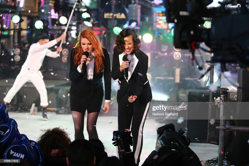 Aino Jawo and Caroline Hjelt of Icona Pop peform on stage during The New Year's Eve 2014 Celebration in Times Square on December 31 2013 in New York...