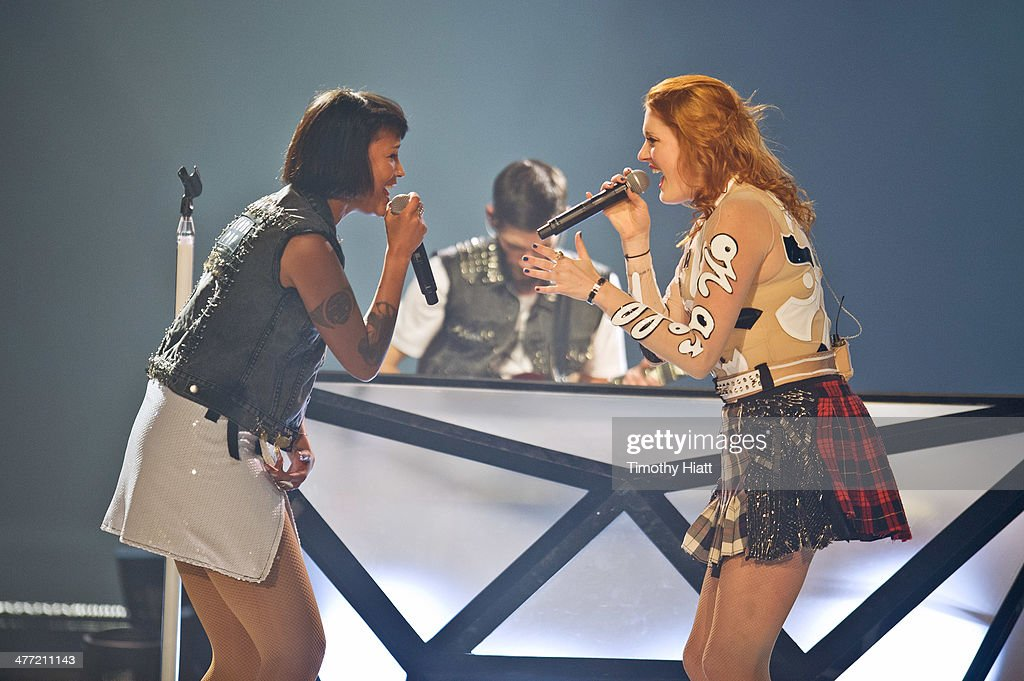 Aino Jawo and Caroline Hjelt of Icona Pop perform as they open for Miley Cyrus during her Bangerz tour at Allstate Arena on March 7 2014 in Rosemont...