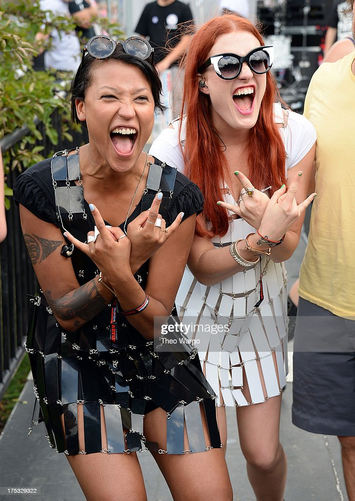Aino Jawo and Caroline Hjelt of Icona Pop pose backstage during Lollapalooza 2013 at Grant Park on August 2 2013 in Chicago Illinois