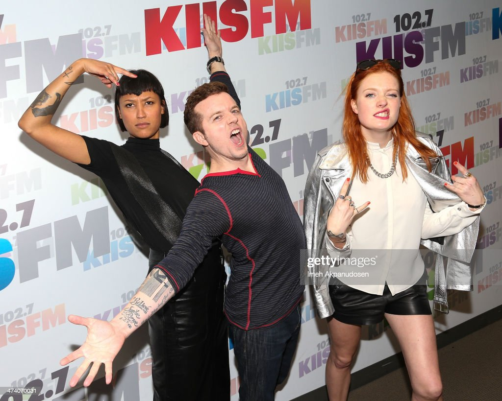 Aino Jawo and Caroline Hjelt of Icona Pop pose with radio personality JoJo Wright following a private performance at Clear Channel Media and...
