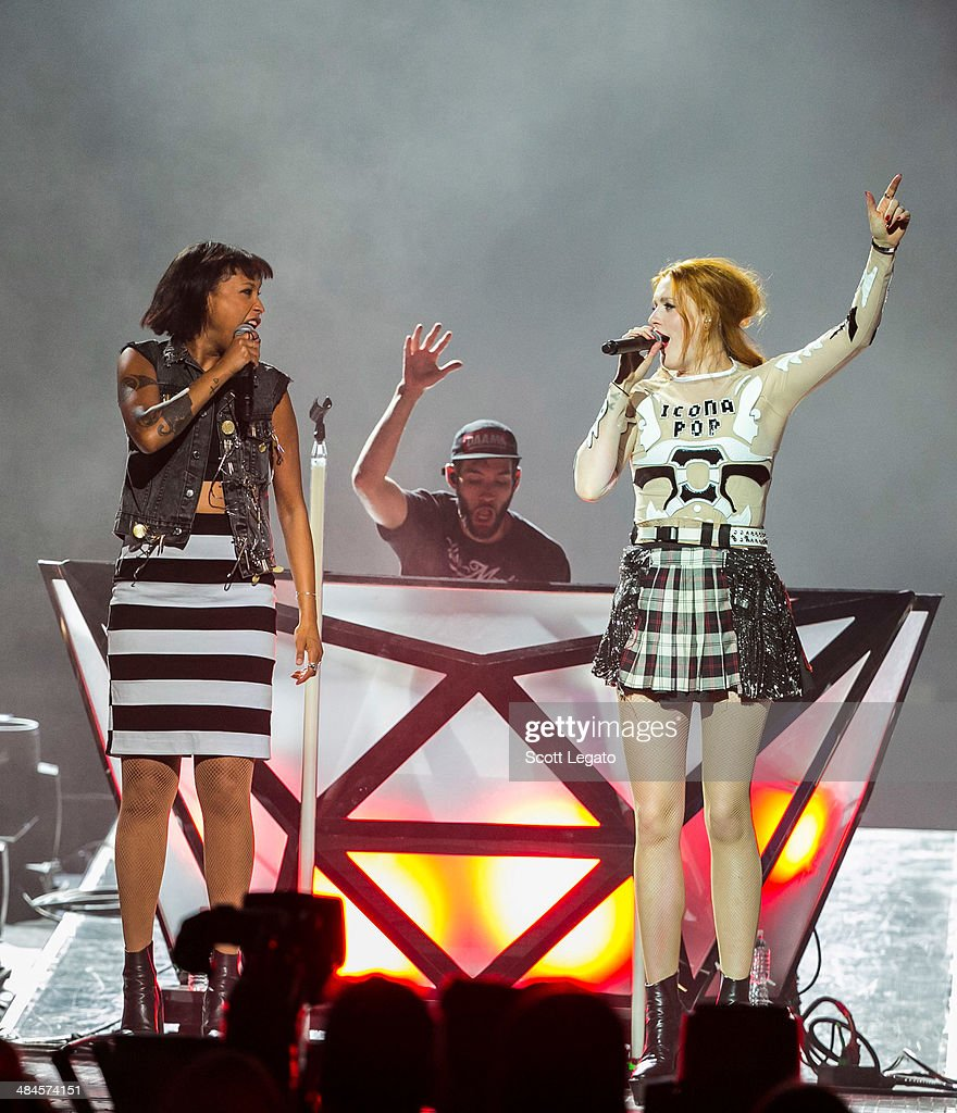 Aino Jawo Duo (L) and Caroline Hjelt of Icona PopIcona Pop performs at The Palace of Auburn Hills on April 12, 2014 in Auburn Hills, Michigan.