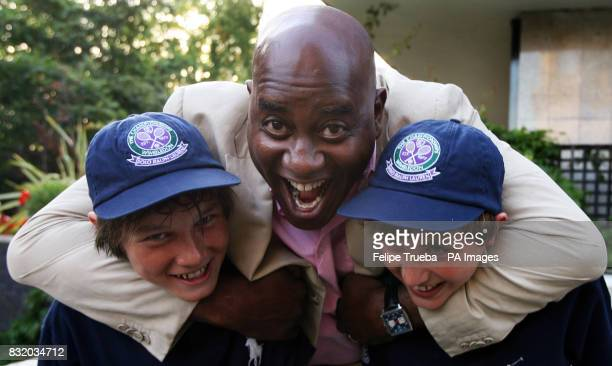 Ainsley Harriot with two Wimbledon ball boys at the A Summer's Evening party hosted by the Earl Countess Spencer in aid of the Sir Cliff Richard...