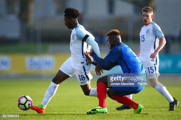 Ainsley Maitland Niles of England is challenged by Joris Gnagnon of France during the UEFA U20 International Friendly match between France and...