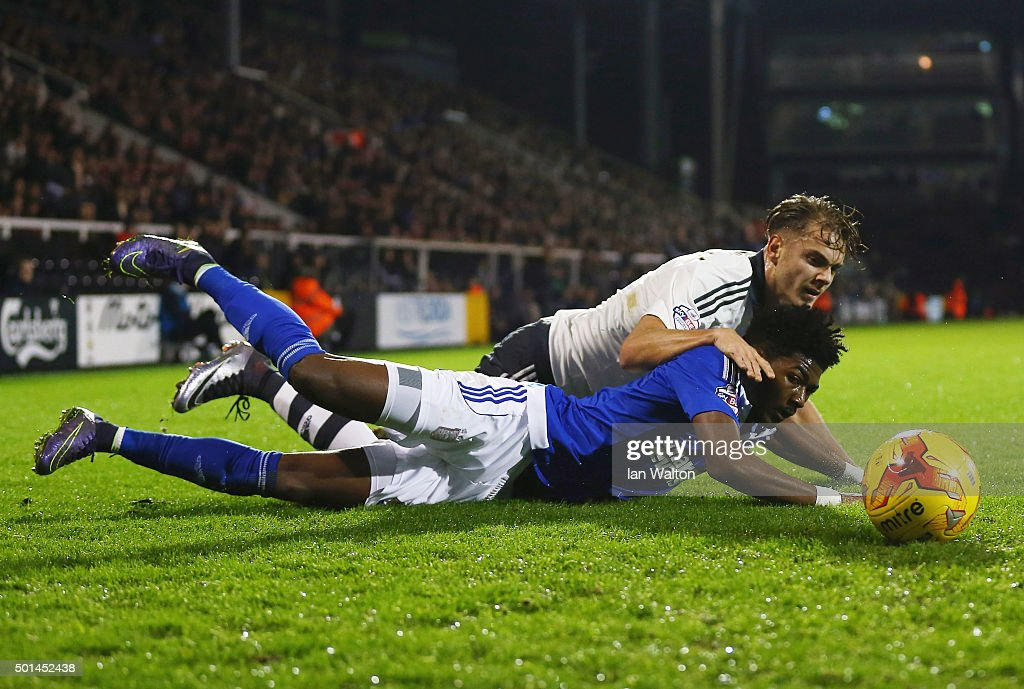 Ainsley Maitland-Miles of Ipswich is tackled Alex Kacaniklic of Fulham during the Sky Bet Football League Championship match between Fulham and Ipswich Town at Craven Cottage on December 15, 2015 in London, United Kingdom.