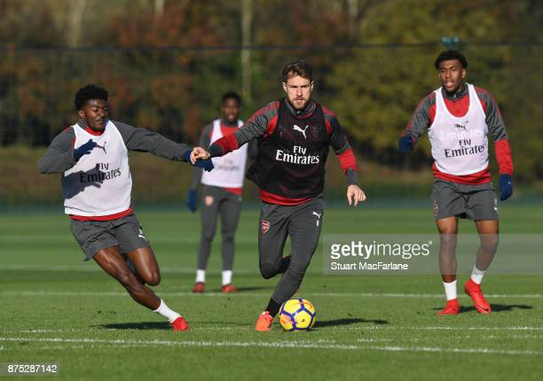 Ainsley MaitlandNiles Aaron Ramsey and Alex Iwobi of Arsenal during a training session at London Colney on November 17 2017 in St Albans England