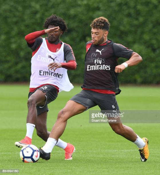Ainsley MaitlandNiles and Alex OxladeChamberlain of Arsenal during a training session at London Colney on August 18 2017 in St Albans England