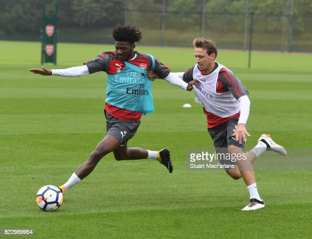 Ainsley MaitlandNiles and Nacho Monreal of Arsenal during a training session at London Colney on July 26 2017 in St Albans England
