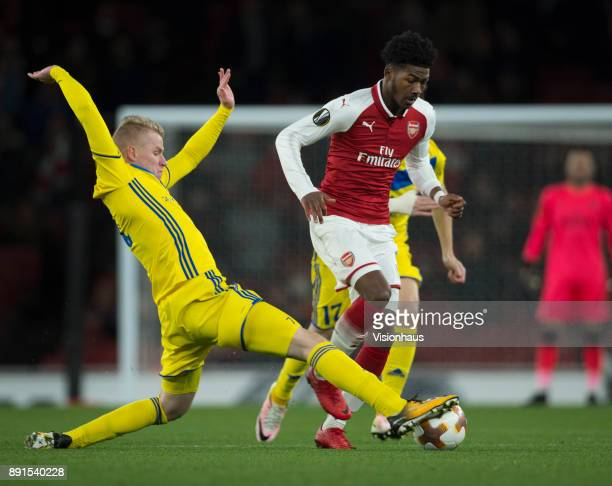Ainsley MaitlandNiles of Arsenal and Evgeni Berezkin of FC Bate Borisov in action during the UEFA Europa League group H match between Arsenal FC and...