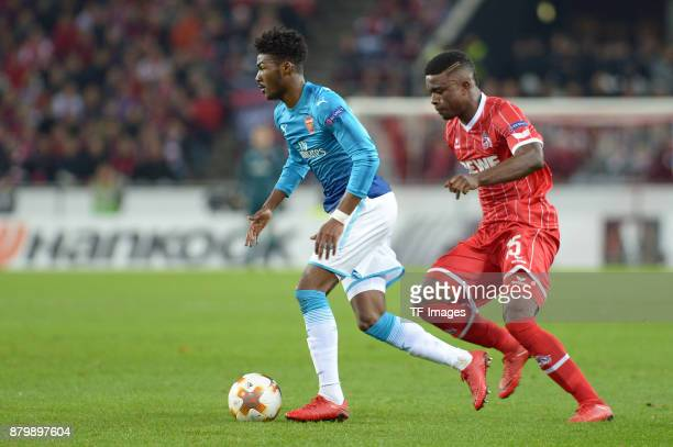 Ainsley MaitlandNiles of Arsenal and Jhon Cordoba of Cologne battle for the ball during the UEFA Europa League Group H soccer match between 1FC...