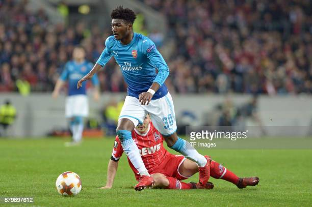 Ainsley MaitlandNiles of Arsenal and Milos Jojic of Cologne battle for the ball during the UEFA Europa League Group H soccer match between 1FC...