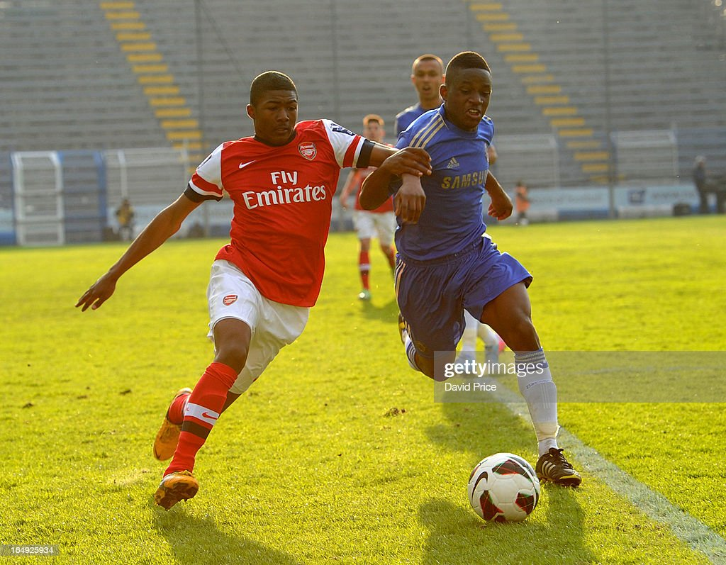 Ainsley Maitland-Niles of Arsenal takes on Kevin Wright of Chelsea during the NextGen Series Semi Final match between Arsenal and Chelsea at Stadio Guiseppe Sinigallia on March 29, 2013 in Como, Italy.