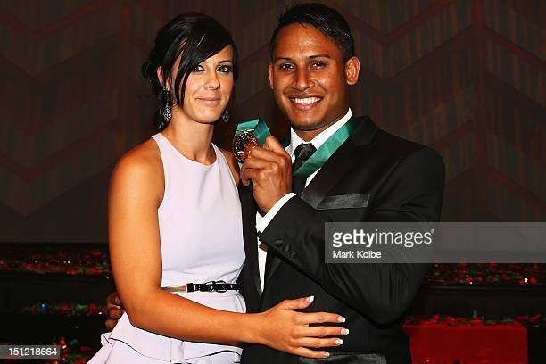 Ainslie Curry sits with Ben Barba as he poses with the Dally M Medal at the 2012 NRL Dally M Awards at Sydney Town Hall on September 4 2012 in Sydney...