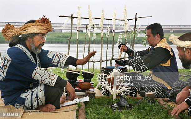 Ainu men carry out a ritual ancestor worshipping ceremony on a river bed in Tokyo Japan on Sunday April 8 2008 Japanese lawmakers passed a resolution...