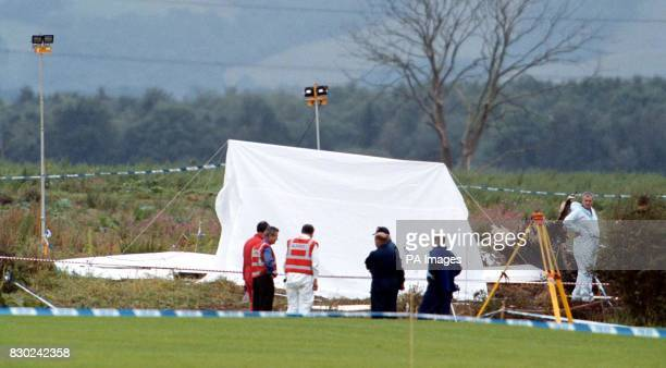 Air Accident investigators looking at the crash site of the twin engine Cessna 404 which crashed killing eight people just outside Glasgow Airport