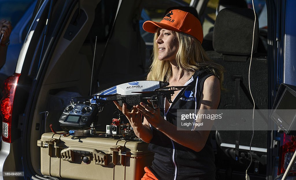 Air Angel Ashley Byrne holds a drone designed to monitor illegal hunting activity at on October 21, 2013 in Norton, Massachusetts.