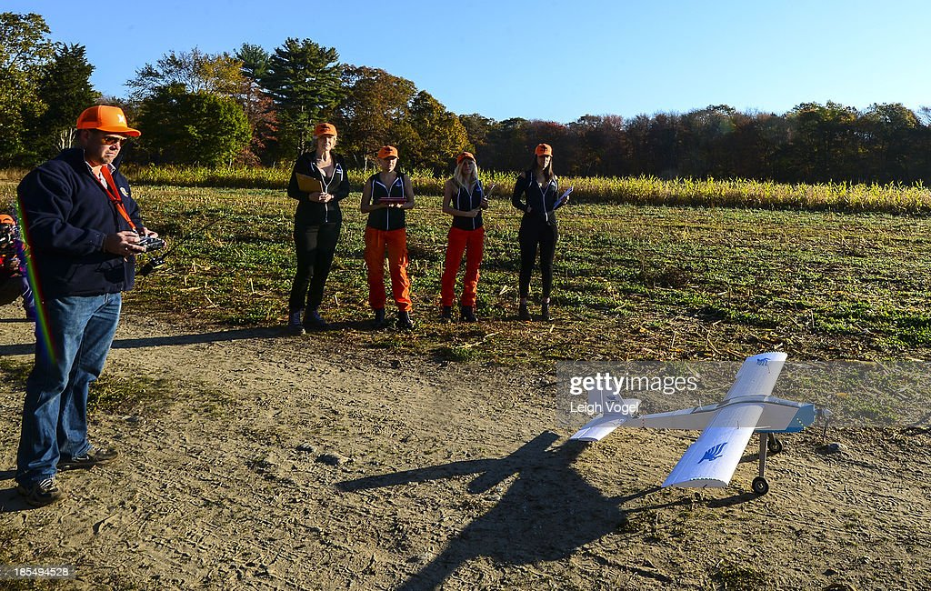 Air Angels watch as a drone takes off at Erwin Wilder Wildlife Mangement Area that is designed to capture footage of illegal hunting activities at on October 21, 2013 in Norton, Massachusetts.