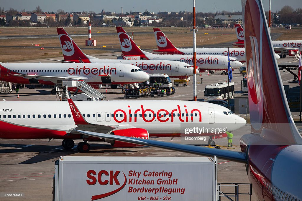 Air Berlin aircraft sit on the tarmac at Tegel airport, operated by Flughafen Berlin Brandenburg GmbH, in Berlin, Germany, on Wednesday, March 12, 2014. Berlin's Tegel airport has subsisted by chance alone, defying the odds as passenger growth outpaces every other major hub in Western Europe. Photographer: Krisztian Bocsi/Bloomberg via Getty Images