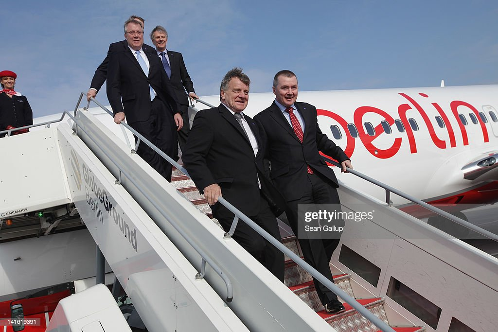 Air Berlin CEO <a gi-track='captionPersonalityLinkClicked' href=/galleries/search?phrase=Hartmut+Mehdorn&family=editorial&specificpeople=613038 ng-click='$event.stopPropagation()'>Hartmut Mehdorn</a> (C) descends with (from L to R) oneworld CEO Bruce Ashby, American Airlines CEO Tom Horton, British Airways CEO Keith Williams and IAG CEO Willie Walsh the boarding ramp to an Air Berlin passenger plane after the five men signed a document confirming Air Berlin's acceptance into the oneworld alliance at Berlin Brandenburg Airport on March 20, 2012 in Berlin, Germany. Air Berlin joins 10 other international airlines in the alliance.