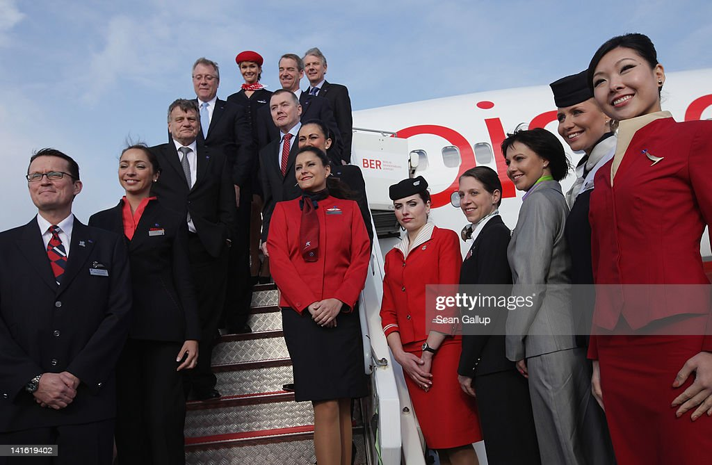 Air Berlin CEO <a gi-track='captionPersonalityLinkClicked' href=/galleries/search?phrase=Hartmut+Mehdorn&family=editorial&specificpeople=613038 ng-click='$event.stopPropagation()'>Hartmut Mehdorn</a> (3rd from L) poses with (from L to R, on the ramp) oneworld CEO Bruce Ashby, American Airlines CEO Tom Horton, British Airways CEO Keith Williams (behind) and IAG CEO Willie Walsh on the boarding ramp to an Air Berlin passenger plane after the five men signed a document confirming Air Berlin's acceptance into the oneworld alliance at Berlin Brandenburg Airport on March 20, 2012 in Berlin, Germany. Air Berlin joins 10 other international airlines in the alliance.