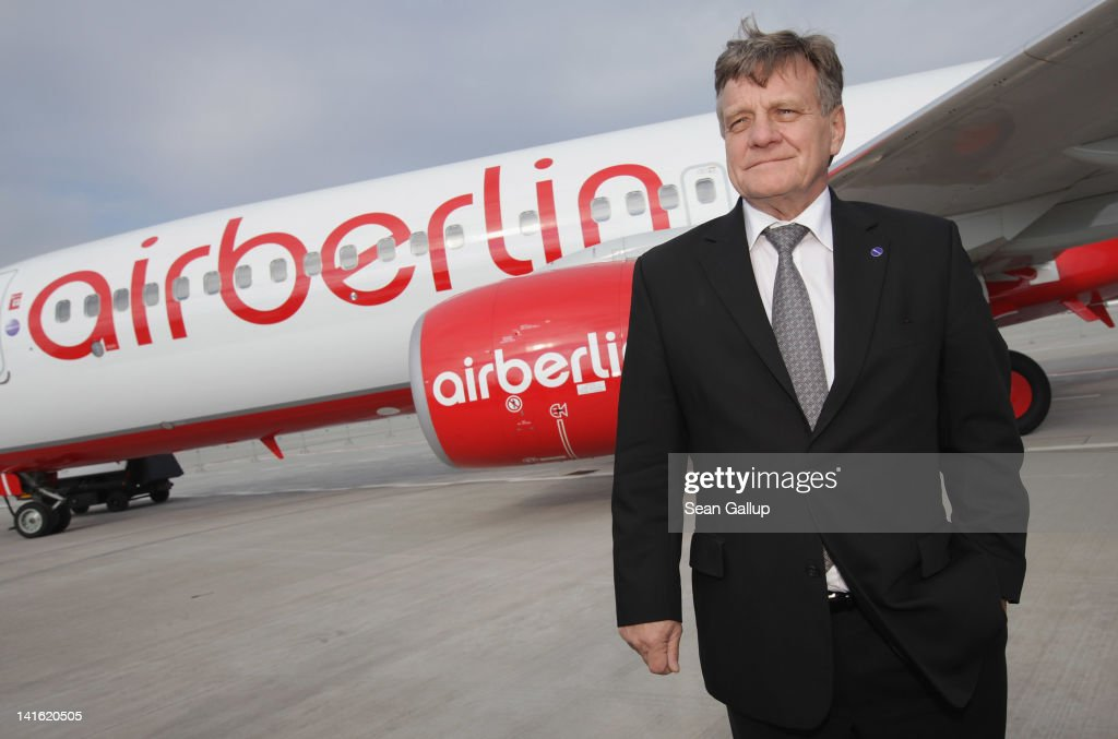 Air Berlin CEO <a gi-track='captionPersonalityLinkClicked' href=/galleries/search?phrase=Hartmut+Mehdorn&family=editorial&specificpeople=613038 ng-click='$event.stopPropagation()'>Hartmut Mehdorn</a> stand next to an Air Berlin passenger plane after he signed a document confirming Air Berlin's acceptance into the oneworld alliance at Berlin Brandenburg Airport on March 20, 2012 in Berlin, Germany. Air Berlin joins 10 other international airlines in the alliance.