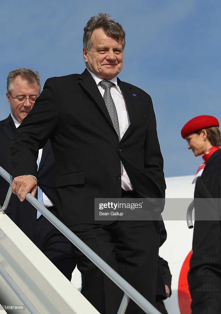 Air Berlin CEO <a gi-track='captionPersonalityLinkClicked' href=/galleries/search?phrase=Hartmut+Mehdorn&family=editorial&specificpeople=613038 ng-click='$event.stopPropagation()'>Hartmut Mehdorn</a> walks down the boarding ramp from an Air Berlin passenger plane after he signed a document confirming Air Berlin's acceptance into the oneworld alliance at Berlin Brandenburg Airport on March 20, 2012 in Berlin, Germany. Air Berlin joins 10 other international airlines in the alliance.