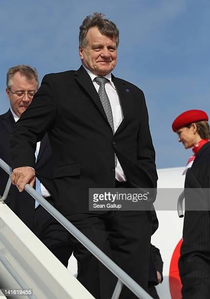 Air Berlin CEO Hartmut Mehdorn walks down the boarding ramp from an Air Berlin passenger plane after he signed a document confirming Air Berlin's...