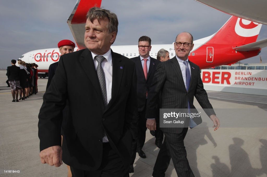 Air Berlin CEO <a gi-track='captionPersonalityLinkClicked' href=/galleries/search?phrase=Hartmut+Mehdorn&family=editorial&specificpeople=613038 ng-click='$event.stopPropagation()'>Hartmut Mehdorn</a> walks on the tarmac next to an Air Berlin passenger plane after he signed a document confirming Air Berlin's acceptance into the oneworld alliance at Berlin Brandenburg Airport on March 20, 2012 in Berlin, Germany. Air Berlin joins 10 other international airlines in the alliance.