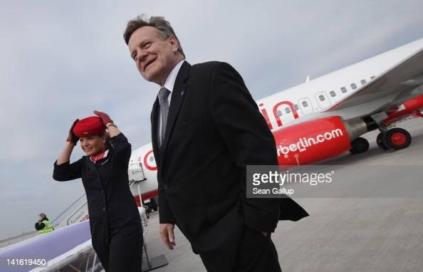 Air Berlin CEO Hartmut Mehdorn walks on the tarmac next to an Air Berlin passenger plane after he signed a document confirming Air Berlin's...
