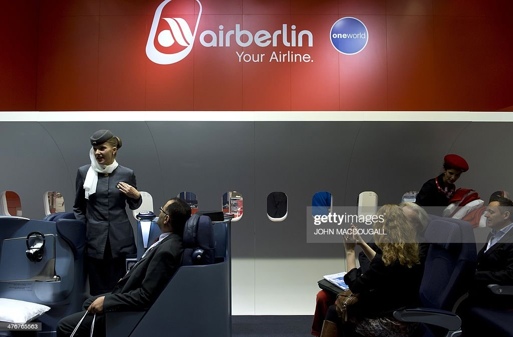 Air Berlin hostesses greet fair-goers in an airplane cabin mock up at the ITB International Travel Trade Fair in Berlin on March 5, 2014. The ITB opens from March 5 to 9, 2014.