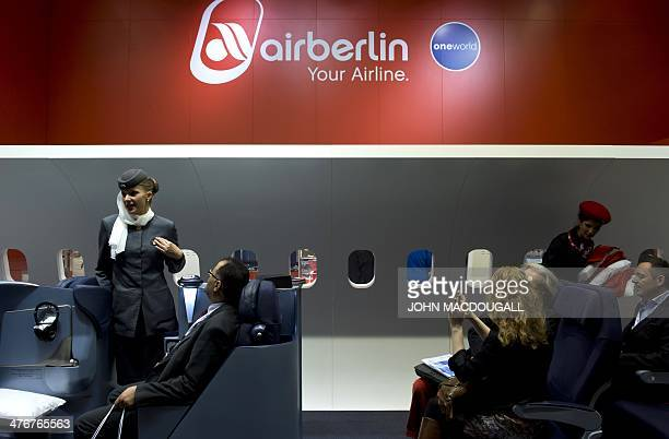 Air Berlin hostesses greet fairgoers in an airplane cabin mock up at the ITB International Travel Trade Fair in Berlin on March 5 2014 The ITB opens...