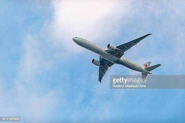 Air Canada Airplane in the distance flying in blue skies Canada's most preferred airline