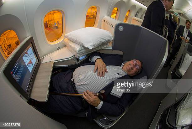 Air Canada frequent flyer Norman Findlay tests out the reclining bed seats in Business Class of the new Boeing 787 Dreamliner that Air Canada took...
