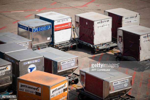 Air cargo boxes are pictured at Tegel Airport on August 8 2017 in Berlin / AFP PHOTO / AXEL SCHMIDT