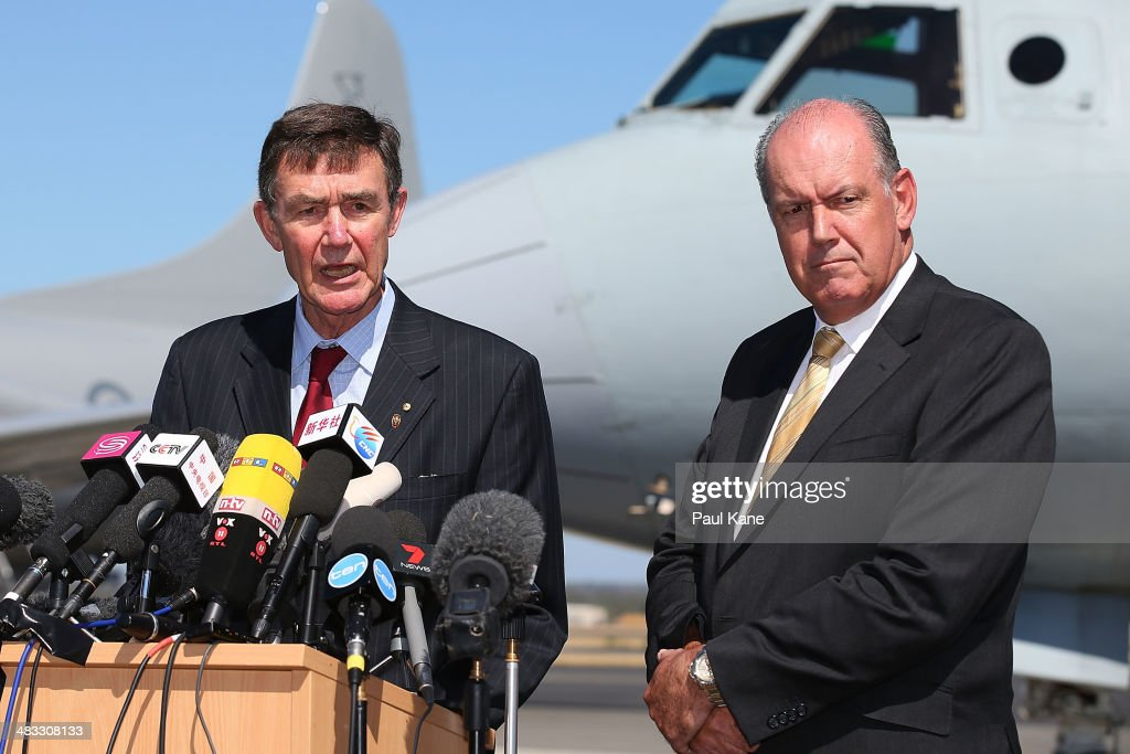 Air Chief Marshal Angus Houston and Defence Minister David Johnston address the media during a press conference over the continuing search for...